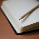 shallow focus photography of pencil on book